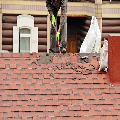 A Roofer Removes Roofing Tiles residential roof installation