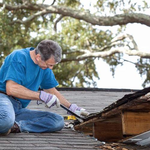 A Roofer Repairs a Leak.