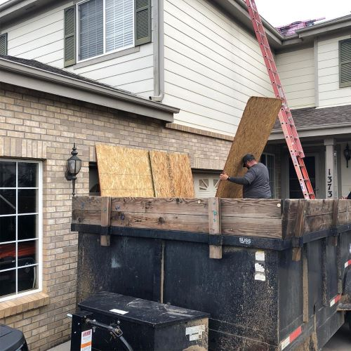 Roofers Work on a impact resistant shingles roof