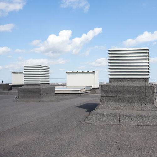 Single-Ply Roofing Material on a Flat Roof.